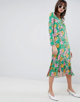 A frilly, floral confection with some serious mod notes. ASOS DESIGN relaxed tea dress in bold floral print, $56 asos.com