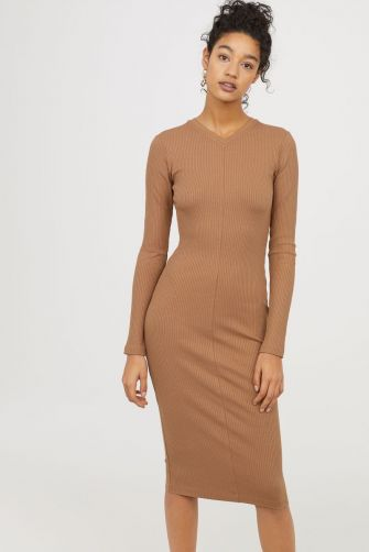 This fitted ribbed knit dress is pretty classic, but a high v-neck on both the front and back gives it a fashionable aesthetic. H&M ribbed jersey high v-neck dress, $59.99 hm.com