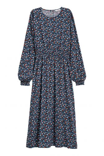 The smocking on this dress is forgiving for that overabundance of food at your holiday meal. H&M woven viscose long sleeve dress, $34.99 hm.com