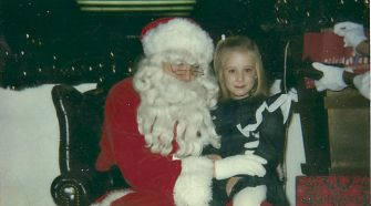 joy to the world abigail jones sits on santas lap as a child - Do Jewish Celebrate Christmas