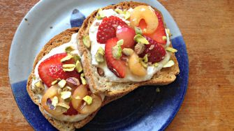 This ricotta toast with cherries, strawberries and pistachios is easy to whip up in minutes.