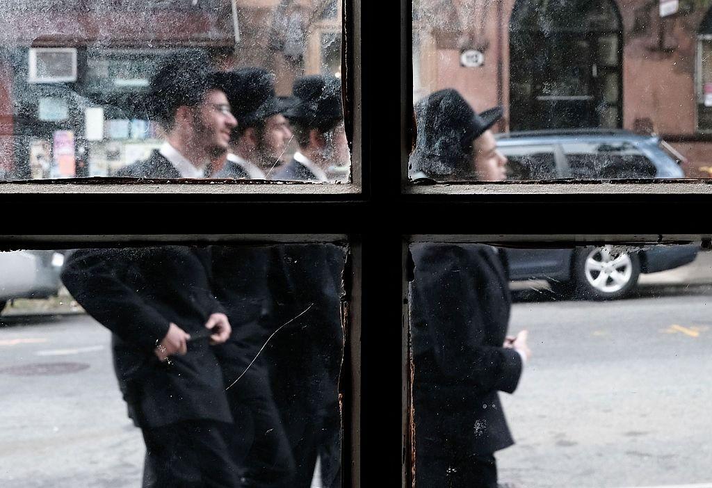 Members of an Orthodox Jewish community in Williamsburg, Brooklyn walk through the neighborhood.