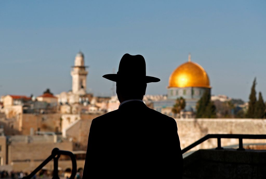 An ultra-Orthodox Jewish man is standing in the Jewish Quarter in Jerusalem's Old City on March 1, 2018, overlooking the Dome of the Rock Mosque.