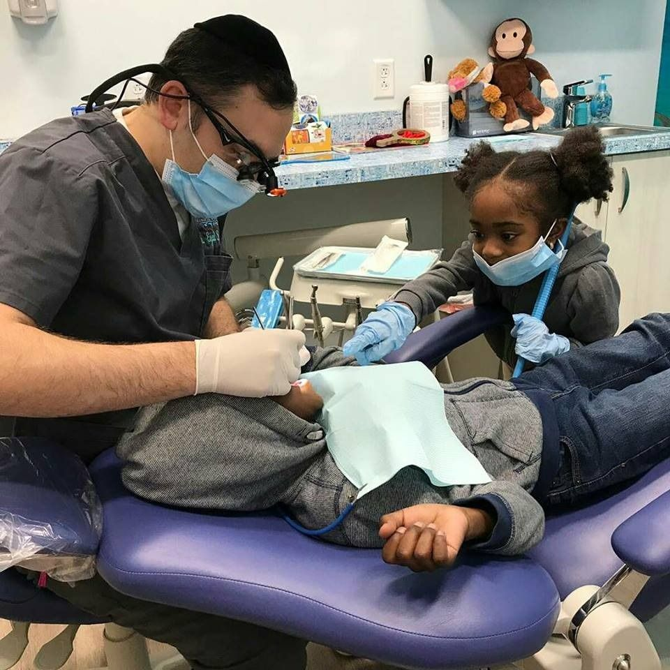 Cute Video Of Dentist Entertaining Toddler Goes Viral