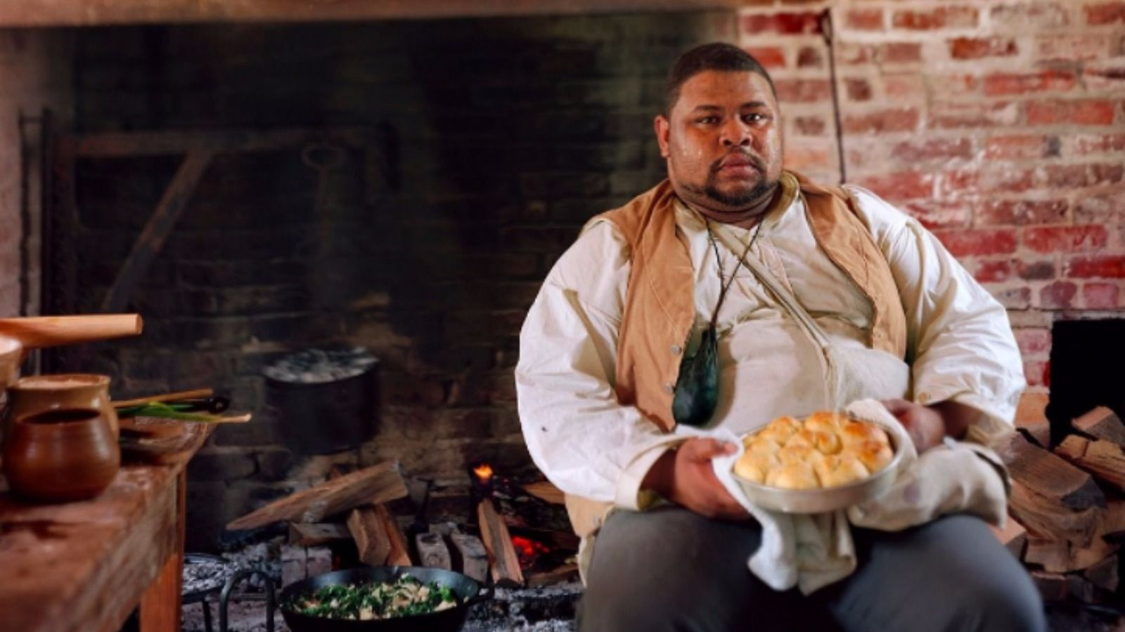 Michael Twitty in the kitchen at Monticello, wearing the clothes of the enslaved to remind visitors how enslaved people built a cuisine, a region and a country.
