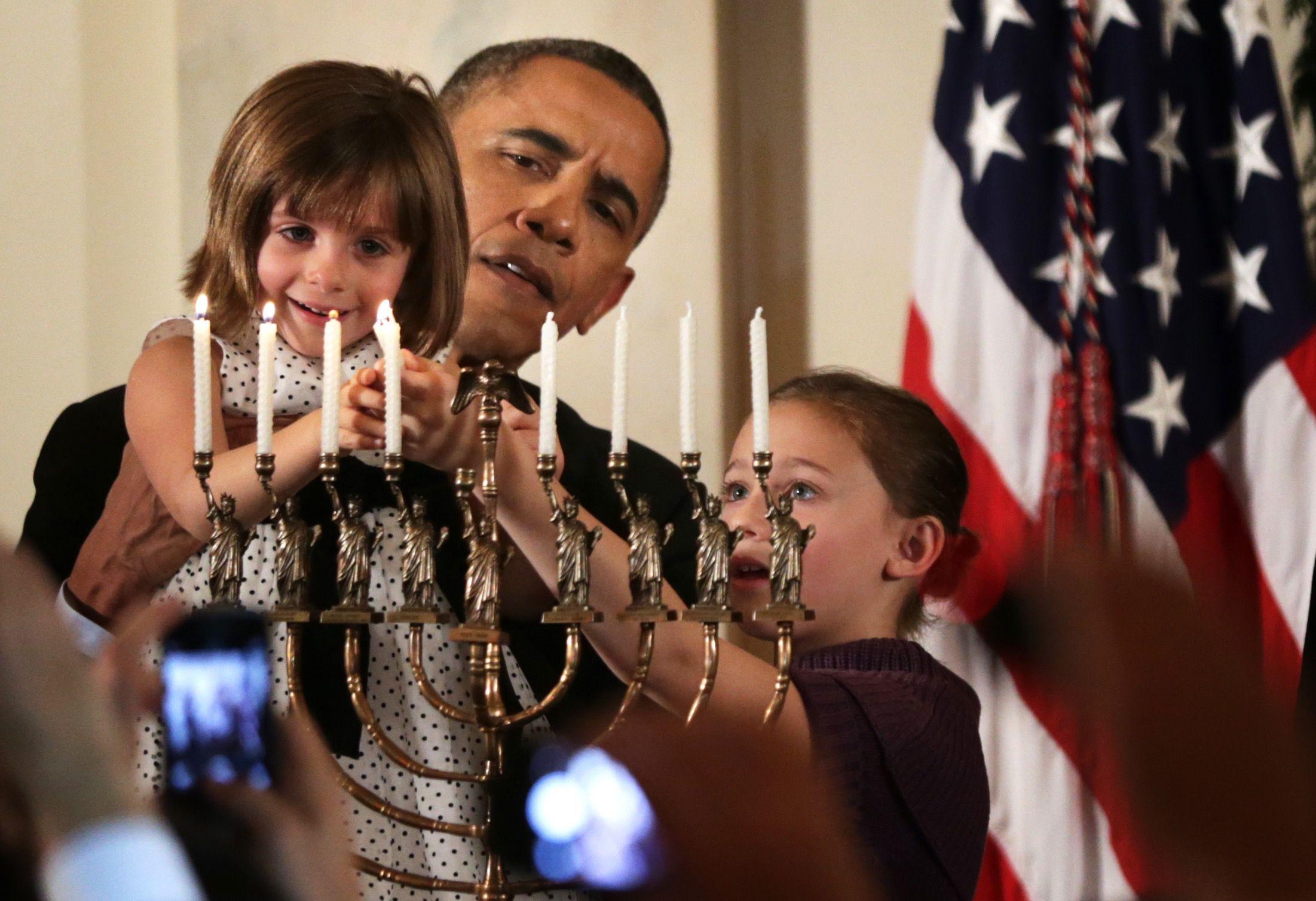 President Obama Lights The Menorah During The White Houseu0027s 2014 Hanukkah  Celebration.